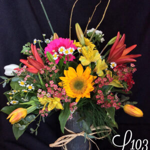 Summer flowers in a rustic metal container
